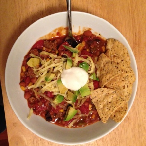 The chili is done when it's thickened and turned a rich red color.